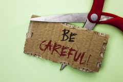 Text sign showing Be Careful. Conceptual photo Caution Warning Attention Notice Care Beware Safety Security written on Tear Cardbo. Text sign showing Be Careful Royalty Free Stock Images