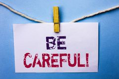 Text sign showing Be Careful. Conceptual photo Caution Warning Attention Notice Care Beware Safety Security written on White Note. Text sign showing Be Careful Royalty Free Stock Images