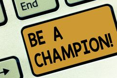 Text sign showing Be A Champion. Conceptual photo Triumph in a competition sport the winner of a contest Keyboard key Intention to. Create computer message stock image
