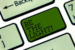 Text sign showing Be The Light. Conceptual photo Enlighten other showing with your attitude be optimistic Keyboard key. Intention to create computer message stock image