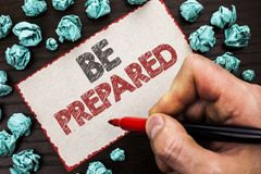 Text sign showing Be Prepared. Conceptual photo Preparedness Challenge Opportunity Prepare Plan Management written by Man Holding. Marker Cardboard Piece the Stock Photos