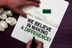 Text sign showing We Believe In Making A Difference. Conceptual photo self-confidence that can be unique Man holding marker notebo. Ok page crumpled papers royalty free stock photography