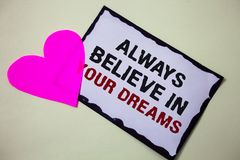 Text sign showing Always Believe In Your Dreams. Conceptual photo confidence Faith Believing in yourself Hart love pink white back. Ground love lovely thoughts stock photos