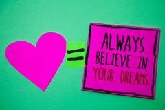 Text sign showing Always Believe In Your Dreams. Conceptual photo confidence Faith Believing in yourself Hart memories love pink g. Reen background love lovely stock image