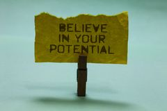 Text sign showing Believe In Your Potential. Conceptual photo Have self-confidence motiavate inspire yourself Paperclip hold torn. Yellow page written brown royalty free stock photography
