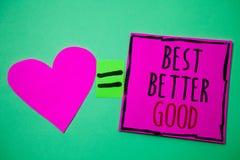 Text sign showing Best Better Good. Conceptual photo improve yourself Choosing best choice Deciding Improvement Hart memories love. Pink green background love stock photos