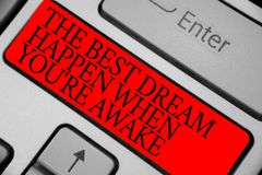 Text sign showing The Best Dream Happen When You re are Awake. Conceptual photo Dreams come true Have to believe Keyboard red key. Intention create computer stock photos