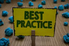 Text sign showing Best Practice. Conceptual photo Method Systematic Touchstone Guidelines Framework Ethic Clothespin holding yello. W paper note crumpled papers stock images