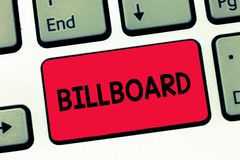 Text sign showing Billboard. Conceptual photo large outdoor board for displaying advertisements hoarding Keyboard key. Intention to create computer message royalty free stock image