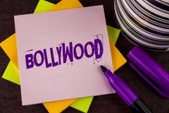 Text sign showing Bollywood. Conceptual photo Indian cinema a source of entertainment written on Sticky note paper on wooden backg. Text sign showing Bollywood Royalty Free Stock Photo