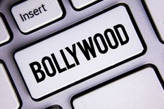 Text sign showing Bollywood. Conceptual photo Indian cinema a source of entertainment written on White Keyboard Key with copy spac. Text sign showing Bollywood Stock Image
