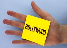 Text sign showing Bollywood. Conceptual photo Indian cinema a source of entertainment written on Yellow Sticky Note Paper placed o. Text sign showing Bollywood Stock Images
