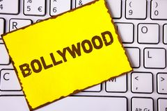 Text sign showing Bollywood. Conceptual photo Indian cinema a source of entertainment written on Yellow Sticky note paper placed o. Text sign showing Bollywood Royalty Free Stock Photos