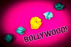 Text sign showing Bollywood Motivational Call. Conceptual photo Hollywood Movie Film Entertainment Cinema Ideas concept pink backg. Round crumpled papers several Stock Photos