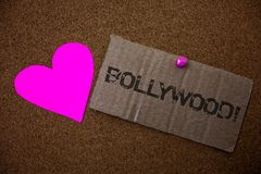 Text sign showing Bollywood Motivational Call. Conceptual photo Hollywood Movie Film Entertainment Cinema Old damaged paperboard i. Deas message purple heart royalty free stock images