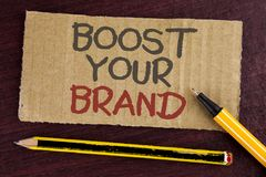 Text sign showing Boost Your Brand. Conceptual photo improve your models name in your field overcome competitors written on Cardbo. Text sign showing Boost Your Royalty Free Stock Photo