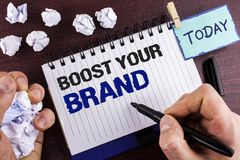 Text sign showing Boost Your Brand. Conceptual photo improve your models name in your field overcome competitors written by Man on. Text sign showing Boost Your Royalty Free Stock Images