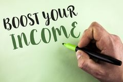 Text sign showing Boost Your Income. Conceptual photo improve your payment Freelancing Part time job Improve written by Man holdin. G Marker in Hand plain Stock Image