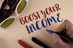 Text sign showing Boost Your Income. Conceptual photo improve your payment Freelancing Part time job Improve written by Man on pla. Text sign showing Boost Your Stock Images