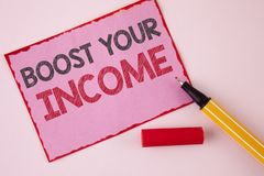 Text sign showing Boost Your Income. Conceptual photo improve your payment Freelancing Part time job Improve written on Pink Stick. Text sign showing Boost Your Stock Photo