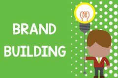 Text sign showing Brand Building. Conceptual photo Generating awareness Establishing and promoting company Standing man. Text sign showing Brand Building royalty free illustration