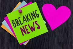 Text sign showing Breaking News. Conceptual photo Special Report Announcement Happening Current Issue Flashnews Papers Romantic lo stock images