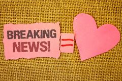 Text sign showing Breaking News Motivational Call. Conceptual photo Updated press report Latest information Text pink torn note eq stock image