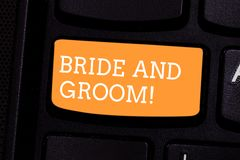 Text sign showing Bride And Groom. Conceptual photo Man and woanalysis who are about to get married Main couple Keyboard royalty free stock photo