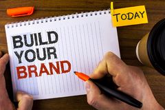 Text sign showing Build Your Brand. Conceptual photo create your own logo slogan Model Advertising E Marketing written by Man on N. Text sign showing Build Your royalty free stock photos