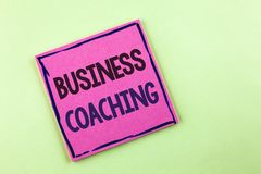Text sign showing Business Coaching. Conceptual photo consulting expert your field Experience improvement written on Pink Sticky N. Text sign showing Business Royalty Free Stock Images