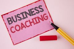 Text sign showing Business Coaching. Conceptual photo consulting expert your field Experience improvement written on Pink Sticky N. Text sign showing Business Royalty Free Stock Photos