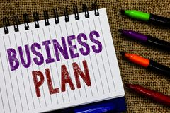 Text sign showing Business Plan. Conceptual photo Structural Strategy Goals and Objectives Financial Projections Open spiral noteb stock photography