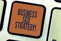 Text sign showing Business Seo Strategy. Conceptual photo Optimization of website to rise the number of visits Keyboard. Key Intention to create computer stock images