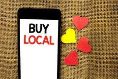 Text sign showing Buy Local. Conceptual photo Buying Purchase Locally Shop Store Market Buylocal Retailers written on Cardboard Pi. Text sign showing Buy Local Royalty Free Stock Photo