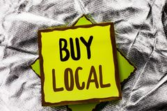 Text sign showing Buy Local. Conceptual photo Buying Purchase Locally Shop Store Market Buylocal Retailers written on Stacked Stic. Text sign showing Buy Local Stock Photography
