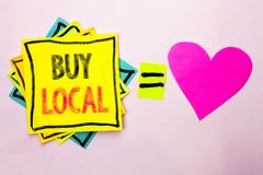Text sign showing Buy Local. Conceptual photo Buying Purchase Locally Shop Store Market Buylocal Retailers written on Stacked Stic. Text sign showing Buy Local Stock Photos