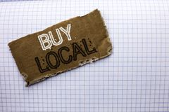Text sign showing Buy Local. Conceptual photo Buying Purchase Locally Shop Store Market Buylocal Retailers written on tear Cardboa. Text sign showing Buy Local Stock Photos