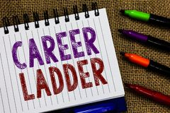 Text sign showing Career Ladder. Conceptual photo Job Promotion Professional Progress Upward Mobility Achiever Open. Spiral notebook page jute background royalty free stock image