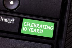 Text sign showing Celebrating 10 Years. Conceptual photo Commemorating a special day Decennial anniversary Keyboard key. Intention to create computer message stock image