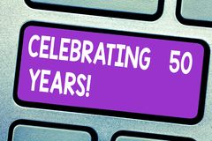 Text sign showing Celebrating 50 Years. Conceptual photo Golden Anniversary Commemorating a special day Keyboard key. Intention to create computer message royalty free stock images