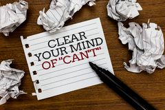 Text sign showing Clear Your Mind Of Can t not. Conceptual photo Have a positive attitude thinking motivation Paper lumps laid ran. Domly around white notepad Royalty Free Stock Photography