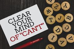 Text sign showing Clear Your Mind Of Can t not. Conceptual photo Have a positive attitude thinking motivation Written paper red ma. Rker beside round woody Royalty Free Stock Images