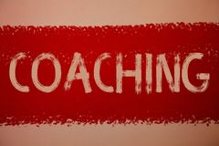 Text sign showing Coaching. Conceptual photo Prepare Enlightened Cultivate Sharpening Encourage Strenghten Ideas messages red pain. T painting light brown royalty free stock photo