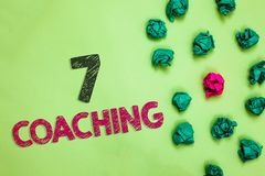 Text sign showing 7 Coaching. Conceptual photo Refers to a number of figures regarding business to be succesful Crumpled wrinkled. Papers one different pink stock images