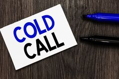 Text sign showing Cold Call. Conceptual photo Unsolicited call made by someone trying to sell goods or services Important idea ide. As notebook marker markers royalty free stock image