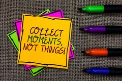 Text sign showing Collect Moments, Not Things. Conceptual photo Happiness philosophy enjoy simple life facts Written on some color. Ful sticky note 4 pens laid stock photo
