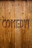 Text sign showing Comedy Call. Conceptual photo Fun Humor Satire Sitcom Hilarity Joking Entertainment Laughing Ideas messages wood. En background intentions royalty free stock photos