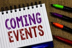 Text sign showing Coming Events. Conceptual photo Happening soon Forthcoming Planned meet Upcoming In the Future Open. Spiral notebook page jute background royalty free stock photography