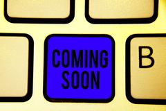 Text sign showing Coming Soon. Conceptual photo something is going to happen in really short time of period Keyboard blue key Inte. Ntion create computer royalty free stock photography