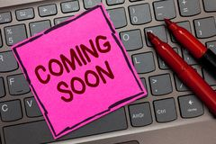 Text sign showing Coming Soon. Conceptual photo something is going to happen in really short time of period Pink paper keyboard In. Spiration communicate ideas stock photos